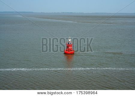 Netherlands,waddenzee-june 2016: Buoy marks the fairway on the wadden sea