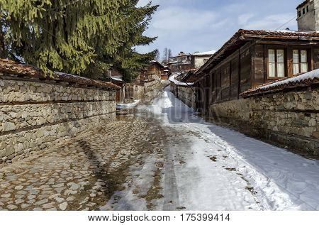 Antique cobblestone street with beauty ancient houses, town Koprivshtitsa, Bulgaria