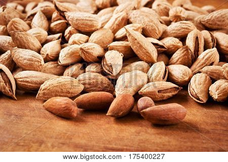 Almond in shell on wooden table for paleo diet