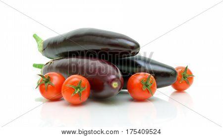 Eggplant and tomatoes on a white background. Horizontal photo.