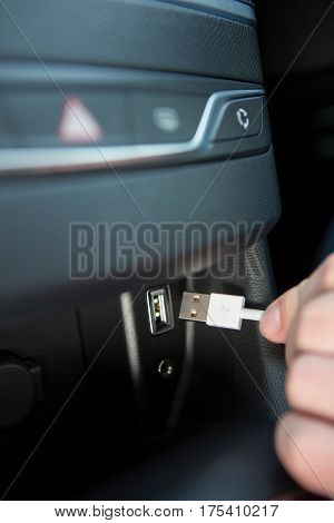 Close Up Of Hand Holding USB Connector In Car