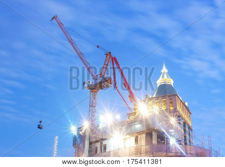 Crane at onstruction site  and twilight light scene