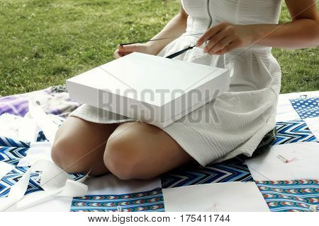 Happy Boho Woman Opening Present At Her Bridal Shower In Summer Park,joyful Moment At Party Or Weddi