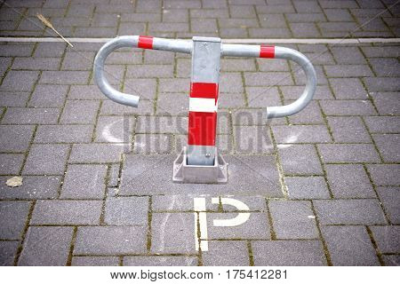 A parking barrier or parking bracket on a private parking lot.