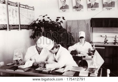 VITEBSK BELARUS - CIRCA 1986: Students of first course of Vitebsk State Order of Friendship of Peoples Medical Institute in classroom at Department of Biology (vintage black and white photo 1986)