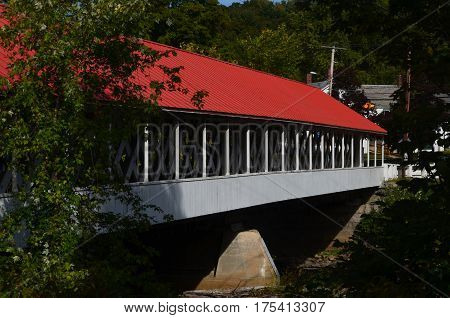 A red and white wooden covered bridge