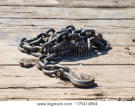 Heavy duty chain on the deck of a flatbed trailer used to tie down equipment while in transit.