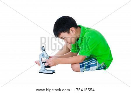 Full Body Of Asian Child With A Microscope Biological Preparations. Science Education.
