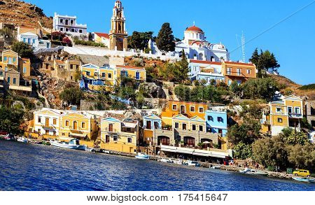 Picturesque colorful houses and monastery Panormitis on the Greek island of Symi