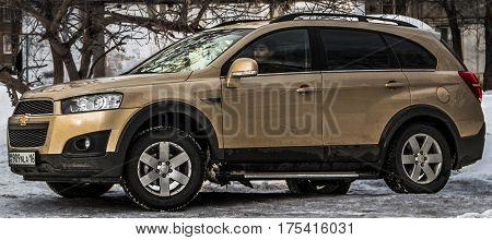 Kazakhstan, Ust-Kamenogorsk, 24 february 2017: Chevrolet Captiva, side view, woman driving