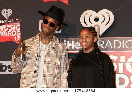 LOS ANGELES - MAR 5:  Ty Dolla Sign, daughter at the 2017 iHeart Music Awards at Forum on March 5, 2017 in Los Angeles, CA