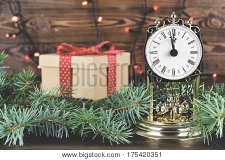 Christmas countdown: Vintage clock  and gift box in background