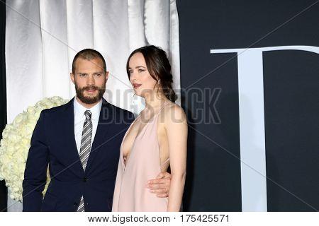 LOS ANGELES - FEB 2:  Jamie Dornan, Dakota Johnson at the