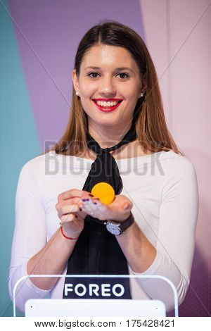 ZAGREB, CROATIA - MARCH 2, 2017: Hostess presents Foreo LUNA mini facial cleansing brush at Foreo's display