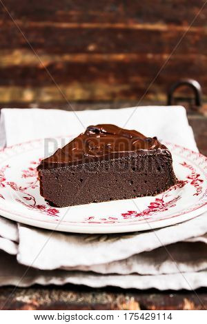 Dark chocolate cake wwith chocolate cream on a dessert plate, selective focus