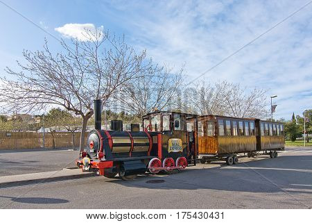 MALLORCA BALEARIC ISLANDS SPAIN - MARCH 7 2017: Tourist train Wine Express offering tours in wine country on March 7 2017 in Mallorca Balearic islands Spain.