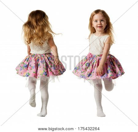 Cute three-year girl is jumping, running, dancing, laughing. Her hair is not combed. Isolated on white background