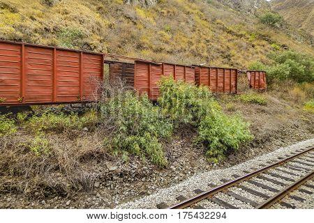 Abandoned wagons at railroad trip to Nariz del Diablo Alausi Ecuador