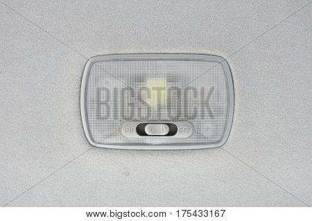 Interior light in car on tapestry background.