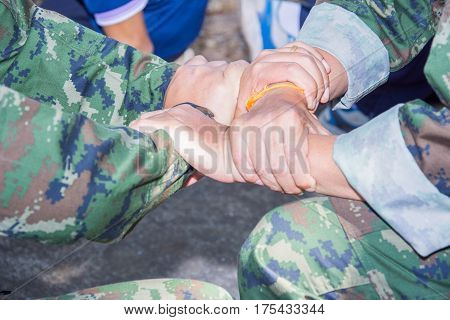 two military holding each others wrists in a circle