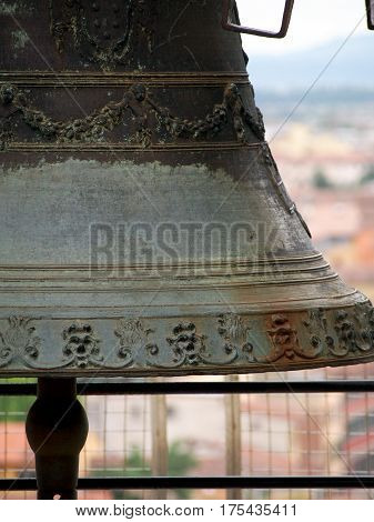 A detail of a large bell in the bell tower of the Leaning Tower of Pisa in Italy.