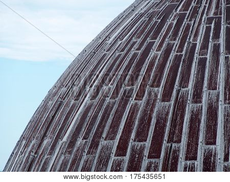 Detail of a rusted dome on tope of a cathedral in Pisa Italy.