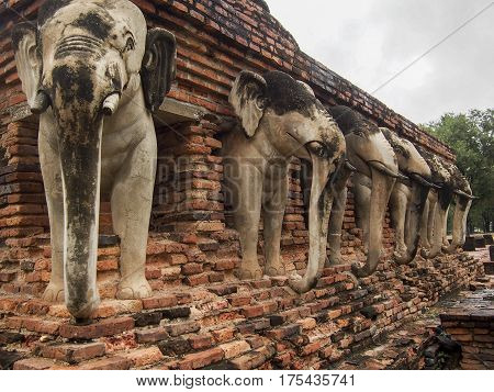 Elephant Statues In Ancient Stupa In Sukhothai Thailand
