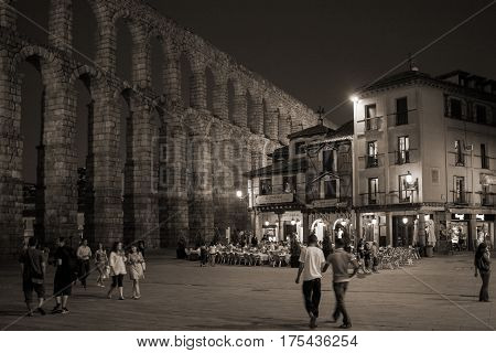 Segovia,Spain-July 24: Street cafe near roman aqueduct in the evening in Segovia, Spain-on July 24 2009