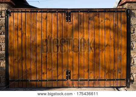 the wooden gate at the entrance to the courtyard