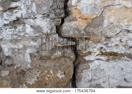 a crack in the old stone wall background