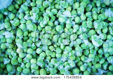 Frozen green peas as a food background