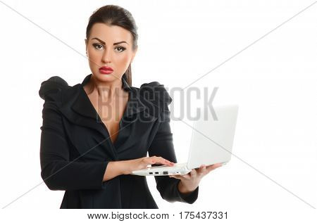 Portrait of a confident young woman with laptop computer on white background
