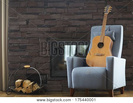 Cozy living room with guitar on the armchair by the fireplace