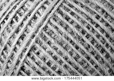 macro of a ball of twine for backgrounds black and white version
