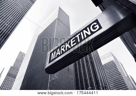 office buildings of new york with a marketing sign