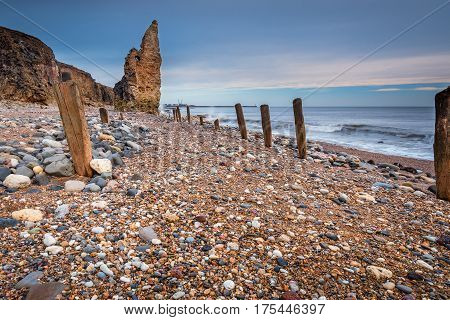 Wooden Piles on Chemical Beach - Dawdon Chemical Beach located on the Durham coastline south of Seaham. The wooden piles were supports for a rail track used to tip mine waste into the sea