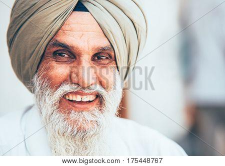 Amritsar, India - August 15, 2016: Smiling sikh portrait in the Sikhism holy Amritsar city.