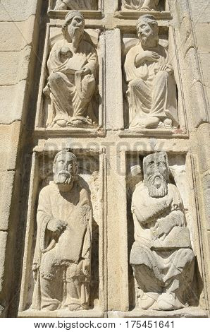 Religious sculptures at the Door of Forgiveness in the cathedral of Santiago de Compostela Galicia Spain