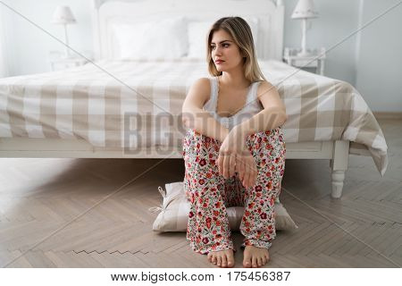 Pensive single woman spending nights lonely and heartbroken
