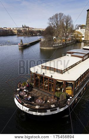 Prague, Czech Republic - March 3: Restaurant Boat Anchored In Front Of Manes Exhibition Hall On Marc