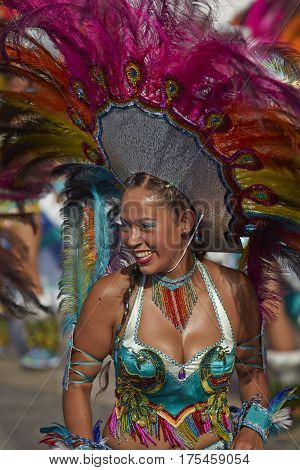 ARICA, CHILE - FEBRUARY 10, 2017: Female member of a Tobas dance group in ornate costume performing at the annual Carnaval Andino con la Fuerza del Sol in Arica, Chile.