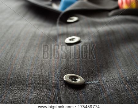 Black Buttons On A Man's Suit Background With Blue Tie., Close Up