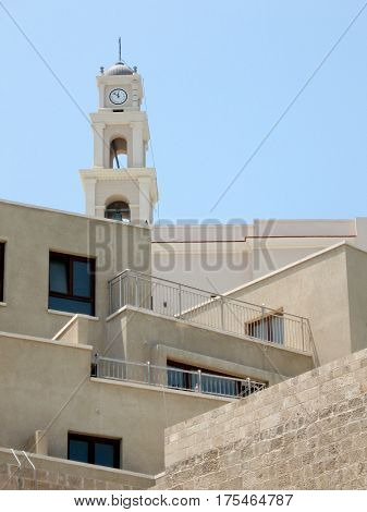 New homes and Bell Tower of St. Peters Church in old city Jaffa Israel