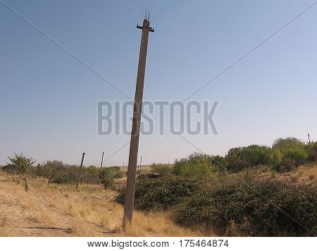 The ruins of the power line in steppe near Mayskiy Uzbekistan