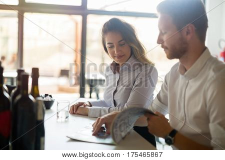 Happy business people formally dressed flirting in cafe