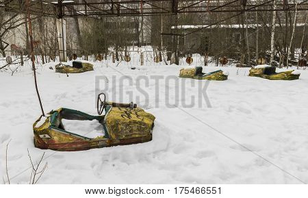 Chernobyl Ukraine - February 19 2017: Yellow dodgems in the snow in Chernobyl in the radio active death zone in Ukrain.