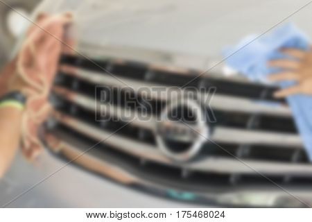 Blurry image Two men were wiping car with hand and microfiber cloth Car cleaning Car washing