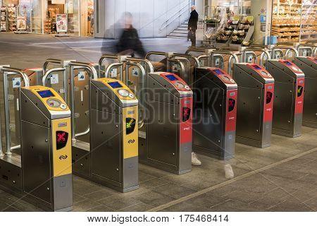 Arnhem The Netherlands - December 23 2016: OV -chip gates for NS and Arriva at railway station Arnhem with shops.