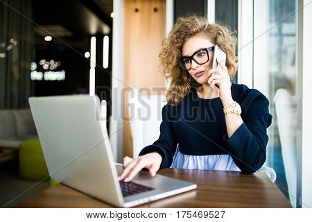 Beautiful businesswoman working sitting at her desk in the office