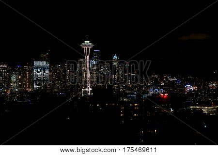 SEATTLE, WASHINGTON, USA - JAN 23rd, 2017: Night Cityscape of Seattle Skyline with Dark Sky Background for Building Lights, panorama seen from Kerry Park, Space Needle in focus.
